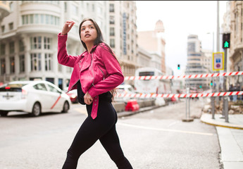 Trendy young woman walking on street