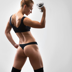 Back of fitness woman.