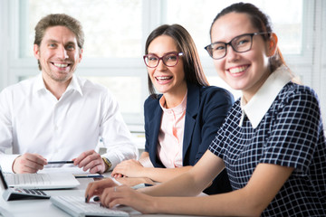 Group young successful business people sitting around the table in a modern office