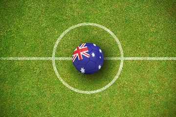 Composite image of football in australia colours