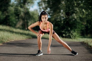 Young sportswoman stretching and preparing to run. Sport Lifestyle.