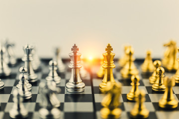 The King in battle chess game stand on chessboard Concept for company strategy,business victory or decision the path to success.