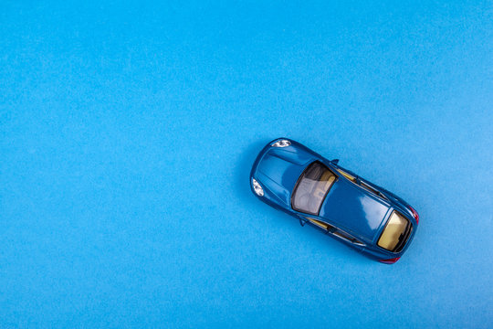 Blue toy car on blue colored background