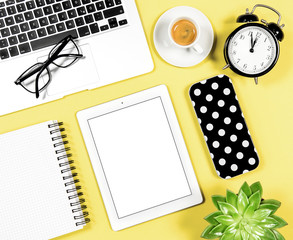 Flat lay office workplace Laptop notebook tablet coffee yellow background