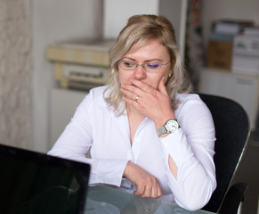 Sad woman thinking about future at job