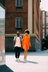 Young couple walking  together on city street