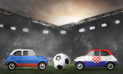 Russia and Croatia flags on cars with soccer or football ball at stadium
