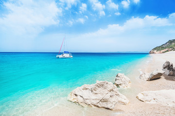 Beautiful lagoon with sailing boat and beach, Lefkada island, Greece