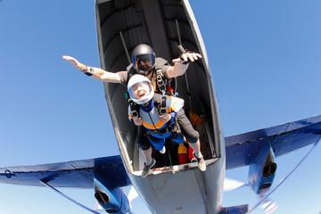 Tandem skydiving. Exit. Wall mural