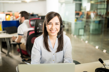 Woman with headset working in office