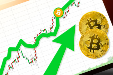 BITCOIN (BTC) index rating go up on exchange market; cryptocurrency chart on tablet pc (smartphone) with arrow pointing up and coins bitcoin. Place for text (prices); top view