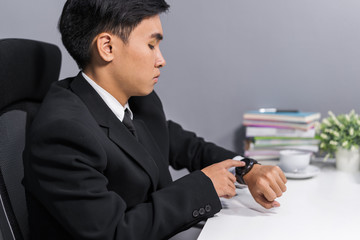 business man checking time on smart watch