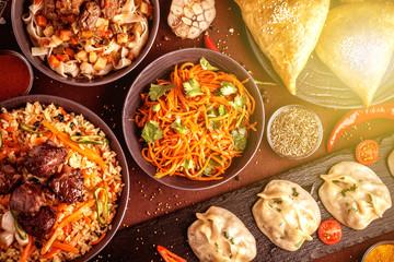 Assorted Uzbek food set, pilaf, samsa, lagman, manta and Korean carrots, Uzbek restaurant concept, Uzbek food feast