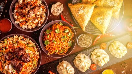 Assorted Uzbek food set, pilaf, samsa, lagman, manta and Korean carrots, Uzbek restaurant concept,...