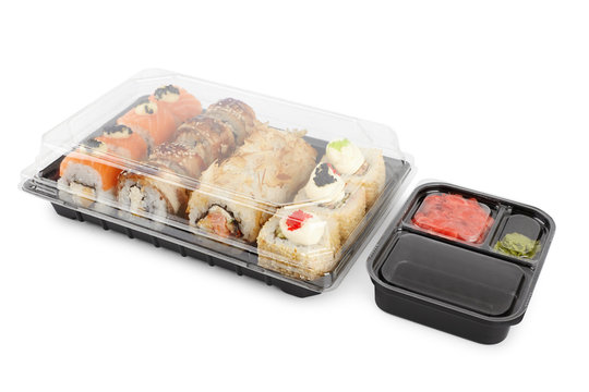 set of sushi rolls in a plastic box, delivered home ready to eat fast healthy food, isolated on white