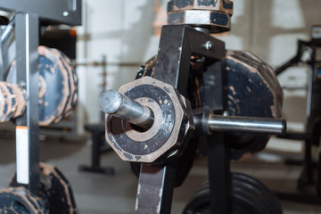 Disassembled barbell on floor in gym.Sports equipment. diverse equipment and machines at the gym room
