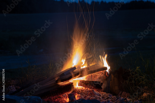 marshmallows roasting over campfire in the evening stock photo and