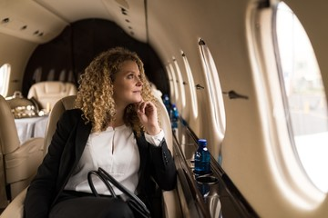 Businesswoman travelling in private jet