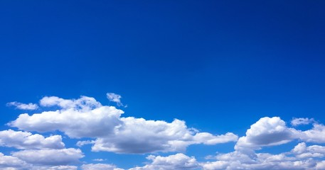Beautiful clouds against a blue sky background. Cloud sky. Blue sky with cloudy weather, nature cloud. White clouds, blue sky and sun.