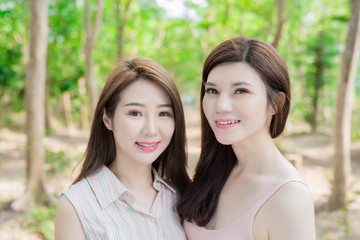 two beauty women smile happily