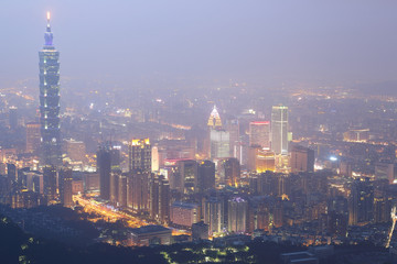 """Aerial view of Taipei City, Taipei 101, Xinyi commercial area, riverside and skyscrapers in downtown in evening twilight ~ Scenery of foggy Taipei City with polluted hazy air (PM 2.5 """"Beyond Index"""" )"""