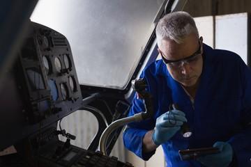 Engineer examining cockpit