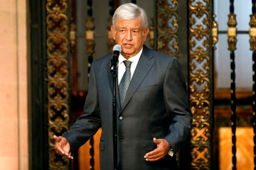 Mexico's president-elect Andres Manuel Lopez Obrador addresses the media after a private meeting with Mexico's President Enrique Pena Nieto at National Palace in Mexico City