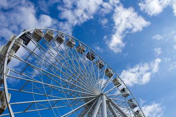 Ferris Wheel Over Blue Sky. Ferris wheel joy sky clouds. Summer