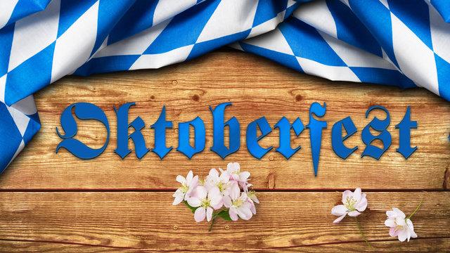 """Tischtuch mit bayrischem Rautenmuster auf Holzuntergrund mit Aufschrift """"Oktoberfest"""""""