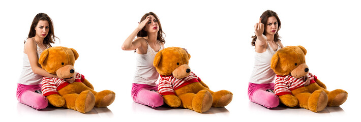 Frustrated pretty brunette girl with pajamas