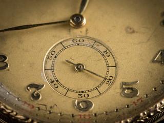 Detail of an old golden pocket watch