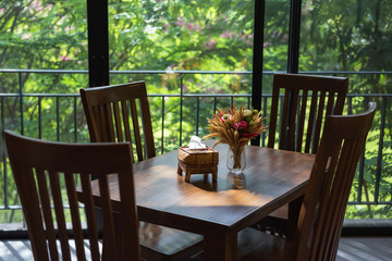 dinning table and flower  with greenery view