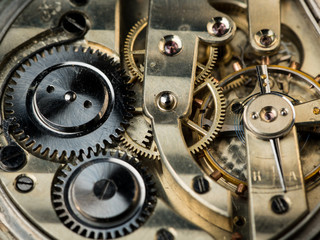 Detail view of the clockwork of an old pocket watch