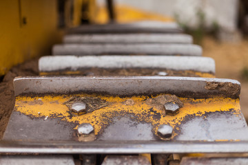 Iron tractor tracks