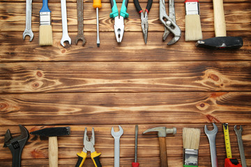 Different tools on brown wooden table