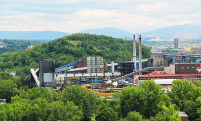 view on the industrial factory and surprisingly green hills in Ostrava, Czech Republic