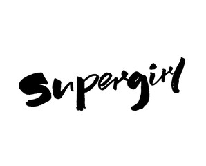 Supergirl - handwritten with brush and ink word. Calligraphy caption, feminism slogan.