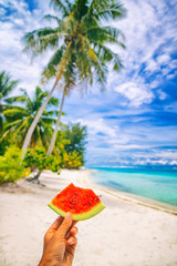 Summer healthy eating woman holding watermelon taking food selfie on tropical beach vacation, Hawaii.