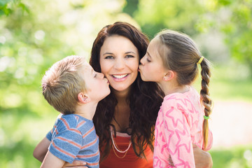Children Kissing Mother