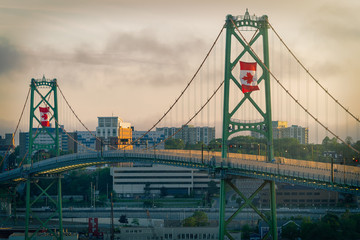 Foto auf AluDibond Bridges The Angus L MacDonald Bridge at dusk on Canada Day with large Canadian flags flying.