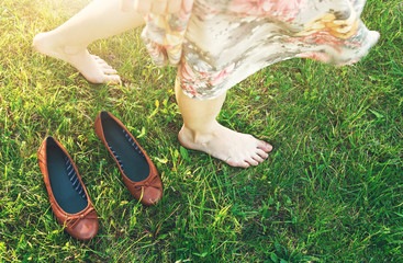 girl walking on grass barefoot without shoes