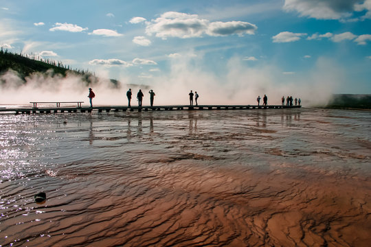 People silhouetted against steam in Yellowstone National Park