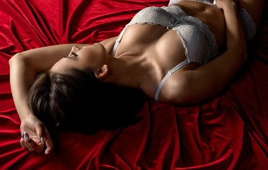 Woman in lingerie experiencing pleasurable moment