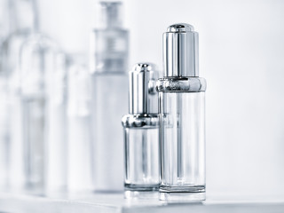 Many different plastic clean transparent three blank bottles with dispenser pump for perfumes or for other liquids
