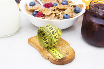 toasted bread with tape measure and healthy breakfast, concept of diet