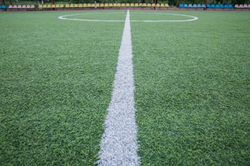 Mini Football Goal On An Artificial Grass . Inside of indoor football field . Mini football stadium center . soccer field center and ball top view background