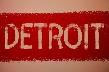 Text sign showing Detroit. Conceptual photo City in the United States of America Capital of Michigan Motown Ideas messages red paint painting light brown background messy intentions.
