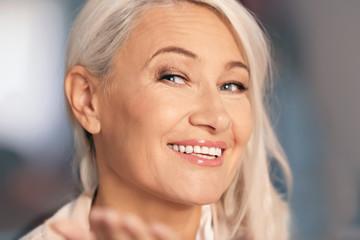 Portrait of smiling mature woman, closeup