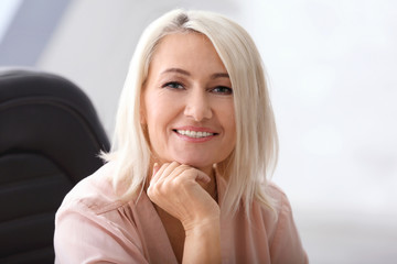 Portrait of smiling mature woman in office