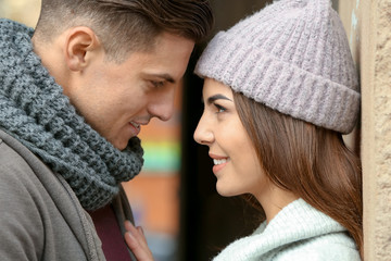 Beautiful couple in warm clothes outdoors